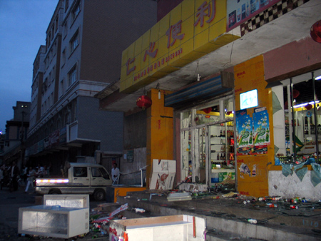 A shop smashed on Tianchi Street in Urumqi